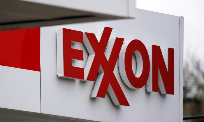 An Exxon sign at a Exxon gas station in Carnegie, Pa., on April 29, 2014. (AP Photo/Gene J. Puskar)