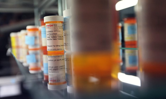 Prescription pill bottles are displayed during a press preview of an auction of the personal effects of Dr. Jack Kevorkian at the New York Institute of Technology on October 27, 2011 in New York City. (Mario Tama/Getty Images)