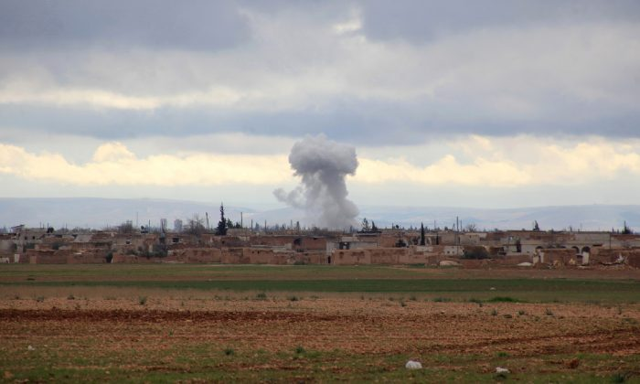 Smoke billows from an ISIS terrorist group position following an air strike by Syrian pro-government forces in Aleppo's eastern countryside on Jan. 24, 2016. (George Ourfalian/AFP/Getty Images)
