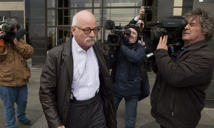 David Lutz, lawyer for Justin Bourque, leaves Moncton Law Courts on Oct. 27, 2014. Bourque used a semi-automatic rifle to kill three RCMP officers and wound two others.  Ron Davis, whose daughter was gunned down in a robbery, wants a renewed debate on firearm control and the federal long-gun registry. (THE CANADIAN PRESS/Andrew Vaughan)