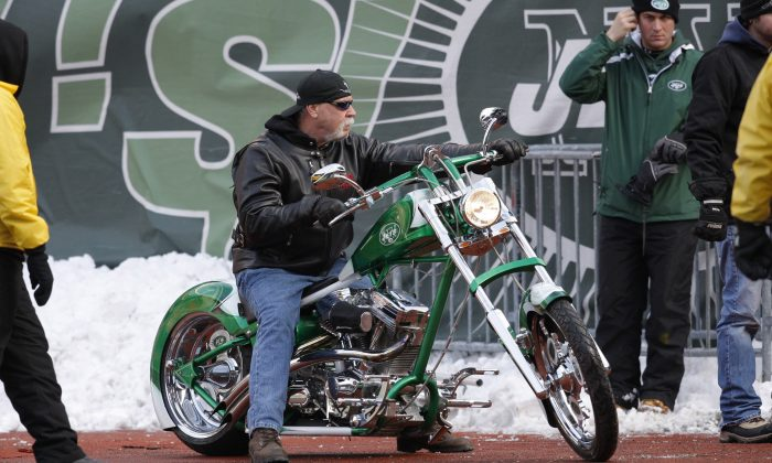 Orange County Choppers' owner Paul Teutel rides a New York Jets-themed chopper onto the field prior to the Jets' NFL football game against the  Atlanta Falcons, Sunday, Dec. 20, 2009, in East Rutherford, N.J. (AP Photo/Kathy Willens)