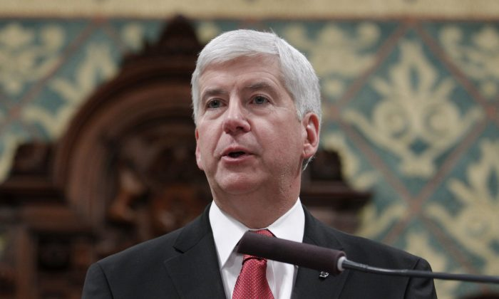 Michigan Gov. Rick Snyder delivers his State of the State address to a joint session of the House and Senate, at the state Capitol in Lansing, Mich., on Jan. 19, 2016. (AP Photo/Al Goldis)