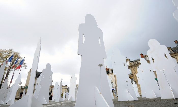 166 silhouettes represent French women victims of violence in 2007 as part of the International Day for the Elimination of Violence Against Women, in Le Mans, on Nov. 25, 2010. (Jean-Francois Monier/AFP/Getty Images)