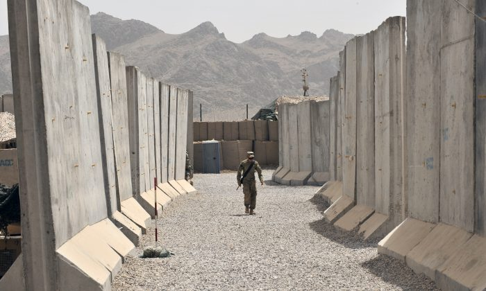 Rows of concrete blast walls are set up at the joint U.S.-Afghan combat outpost in Makuan's village 'Green Zone,' Kandahar Province, southern Afghanistan, heartland of the Taliban, on on Aug. 13, 2011. (Romeo Gacad/AFP/Getty Images)