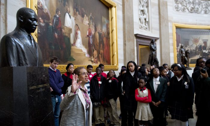 U.S. Congressional Delegate Eleanor Holmes Norton speaks with students about Black History Month alongside a statue of Martin Luther King Jr., during a tour of the Rotunda at the U.S. Capitol in Washington, D.C., on Feb. 20, 2014. (Saul Loeb/AFP/Getty Images)