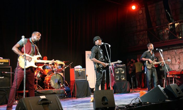Malian band Songhoy Blues performs at the Bamako Acoustik Festival (BAF) in Bamako on on Jan. 27, 2016. BAF hosts African and International artists as Damon Albarn, Tony Allen, Songhoy Blues, Cheikh Tidiane Seck, and dreams of a cultural revival despite a state of emergency instaured after the Nov. 20 deadly terror attack in an hotel. (Sebastien Rieussec/AFP/Getty Images)
