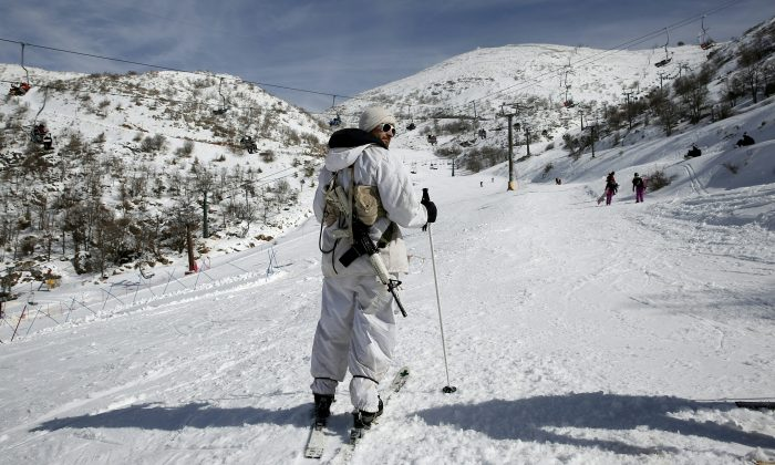 An Israeli soldier of the alpine unit observes skiers on a slope at the Israeli Mount Hermon ski resort, in the Israeli-occupied Golan Heights, on Jan. 21, 2016. For Israelis, the Hermon range, straddling Lebanon and the Syrian and Israeli-held sectors of the Golan, is a highly strategic area under close surveillance. (THOMAS COEX/AFP/Getty Images)