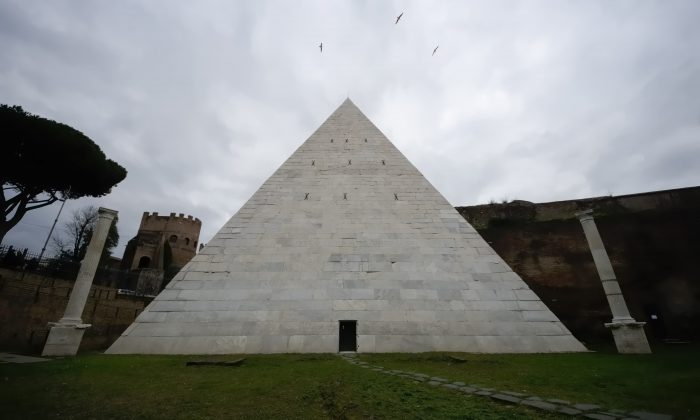 A view of the Pyramid of Cestius in Rome on Feb. 3, 2016. Rome's only surviving pyramid from ancient times is getting fresh visibility. After a Japanese clothing magnate paid for a cleanup, archaeologists are eager to show off the monument, constructed some 2,000 years ago as the burial tomb for a Roman praetor, or magistrate, named Caius Cestius. (AP Photo/Domenico Stinellis)