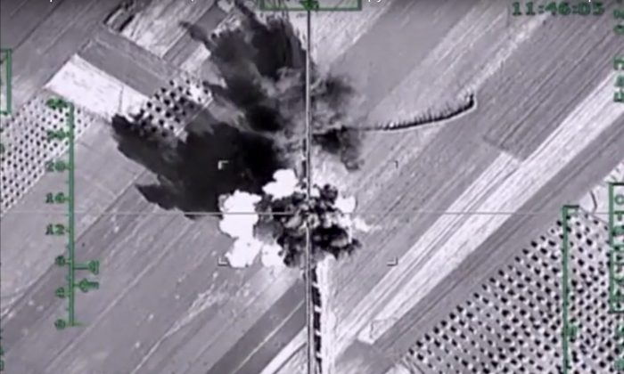 An aerial image shows what it says is a column of heavy trucks carrying ammunition hit by a Russian airstrike near Aleppo, Syria, on Feb. 1, 2016. The Russian military has beefed up its air group in Syria with state-of-the art fighter jets amid tensions with Turkey. (Russian Defense Ministry Press Service photo via AP)