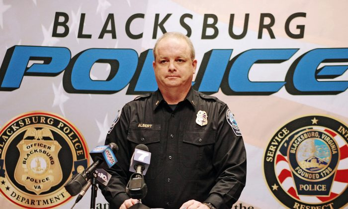 In this Jan. 31, 2016 photo, Blacksburg Lieutenant Mike Albert announces that Virginia Tech student Natalie Keepers was arrested in connection to the death of Nicole Madison Lovell, in Blacksburg, Va. (Edmee Rodriguez/The Roanoke Times via AP)