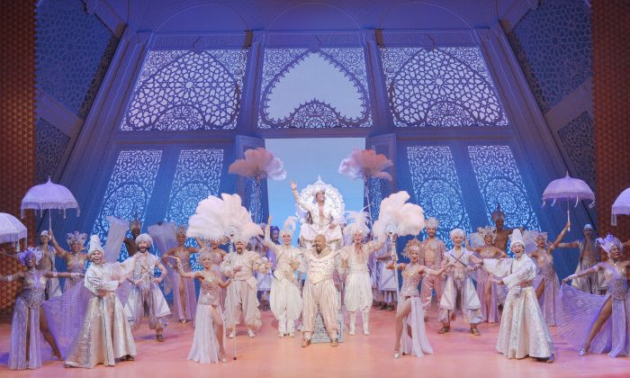 "This image released by Disney Theatrical Productions shows the cast during the ""Prince Ali,"" number in the musical, ""Aladdin,"" in New York. (Deen van Meer/Disney Theatrical Productions via AP)"