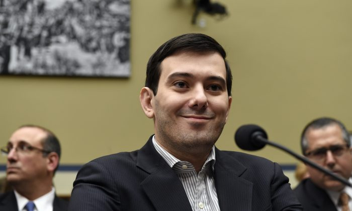 Pharmaceutical chief Martin Shkreli listens on Capitol Hill in Washington, D.C., on Feb. 4, 2016, during the House Committee on Oversight and Reform Committee hearing on his former company's decision to raise the price of a lifesaving medicine. Shkreli refused to testify before U.S. lawmakers who excoriated him over severe hikes for a drug sold by a company that he acquired. (AP Photo/Susan Walsh)