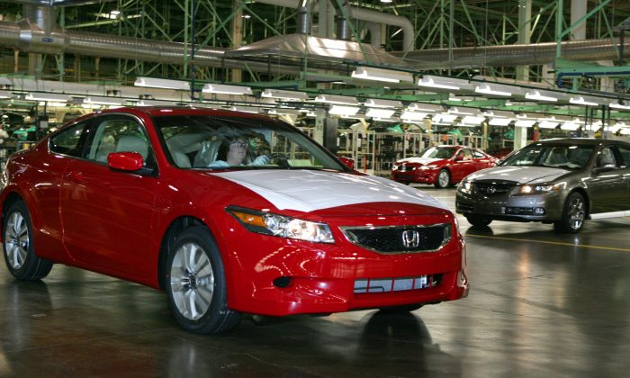 In this Nov. 1, 2007 file photo, a 2008 Honda Accord Coupe, left,  is driven off the assembly line as a 2008 Acura TL waits during production at  Honda of America Manufacturing's Marysville Auto Plant in Marysville, Ohio.  Continental Automotive Systems says in documents filed with the government, Thursday, Feb. 4, 2016,  that moisture can get inside its air bag control computers, causing the power supplies to corrode and fail. If that happens, air bags may not inflate in a crash or they could deploy without a crash. Documents say Continental will notify automakers, who will recall cars dating to 2006. Already Honda, Fiat Chrysler and Mercedes have issued recalls. (AP Photo/Paul Vernon)