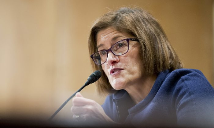 Beth Cobert, President Barack Obama's nominee to head the Office of Personnel Management (OPM), testifies on Capitol Hill in Washington, Thursday, Feb. 4, 2016, before the Senate Homeland Security and Government Affairs Committee  hearing on her nomination.  (AP Photo/Manuel Balce Ceneta)