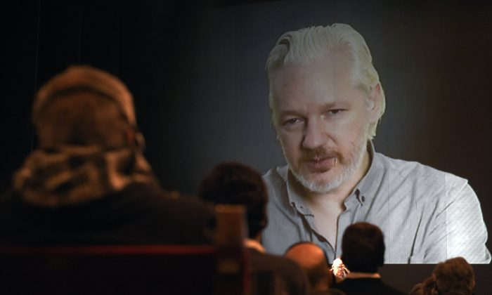 Wikileaks founder Julian Assange (on the screen) takes part in a teleconference during the 2nd International Congress on Universal Jurisdiction in Buenos Aires on Sept. 9, 2015. ( Juan Mabromata/AFP/Getty Images)