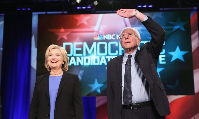 Democratic presidential candidates Hillary Clinton (L) and Senator Bernie Sanders (I-VT) participate in the Democratic Candidates Debate hosted by NBC News and YouTube on Jan. 17, 2016 in Charleston, South Carolina. (Andrew Burton/Getty Images)