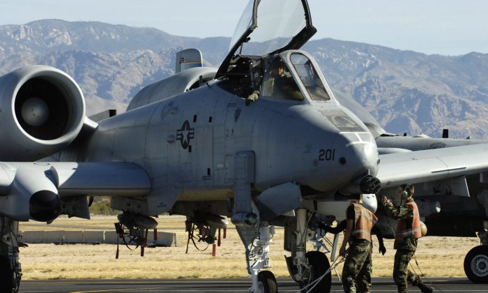 An A-10 Thunderbolt II undergoes pre-flight inspections at Davis-Monthan Air Force Base, Ariz. on March 23, 2006. The retirement of the A-10 is being pushed back to 2022. (U.S. Air Force photo by/Airman 1st Class Jesse Shipps)