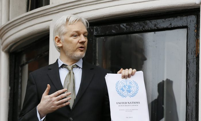 Wikileaks founder Julian Assange. holding a U.N. report speaks on the balcony of the Ecuadorean Embassy in London on Feb. 5, 2016. (AP Photo/Kirsty Wigglesworth)
