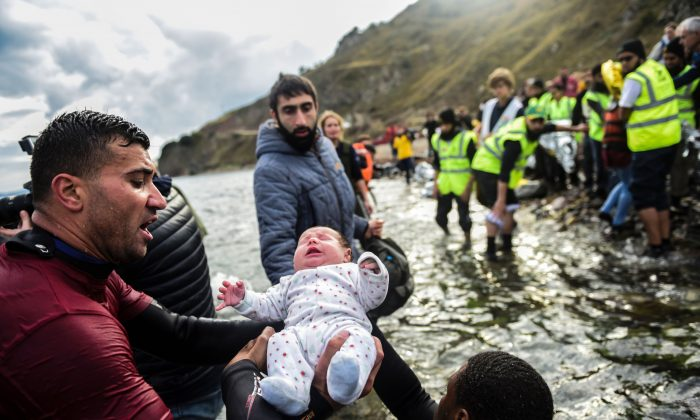 Rescuers, who have been helping migrant families disembark on the Greek island of Lesbos after crossing the Aegean Sea from Turkey, have been nominated for the 2016 Nobel Peace Prize.  (BULENT KILIC/AFP/Getty Images)