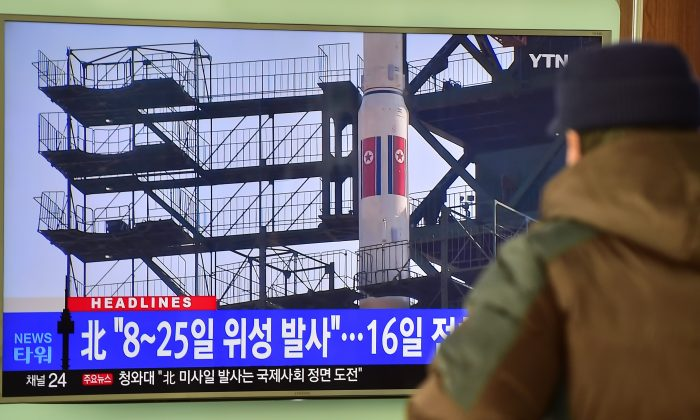 A man watches a news report on North Korea's planned rocket launch as the television screen shows file footage of North Korea's Unha-3 rocket which launched in 2012, at a railway station in Seoul on Feb. 3, 2016. (Jung Yeon-je/AFP/Getty Images)