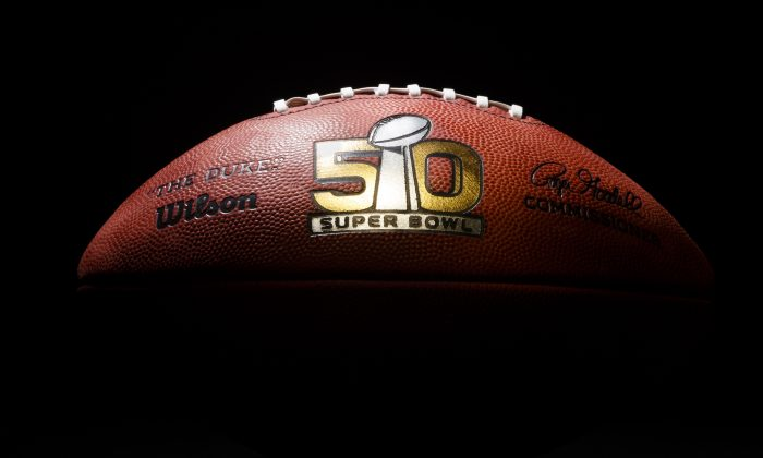 An official game ball for the NFL Super Bowl 50 football game is photographed on Jan. 26, 2016. The Wilson Sporting Goods football factory in Ada, Ohio has made the official Super Bowl football since the first Super Bowl in 1966. The company began making this year's game balls last Sunday night, Jan. 24, immediately after the conclusion of the NFC and AFC championship games. The Denver Broncos will play the Carolina Panthers in the Super Bowl on Feb. 7, in Santa Clara, Calif. (AP Photo/Rick Osentoski)