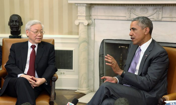President Barack Obama (R) meets with General Secretary Nguyen Phu Trong of Vietnam in the Oval Office of the White House in Washington, D.C., on July 7, 2015. Obama met with Vietnam's Communist Party chief about better relations between the two countries. (Martin H. Simon/Getty Images)
