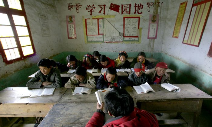 Tibetan students attend a class at Sichuan Province on April 15, 2005. Chinese Internet users reacted with outrage about how some poor students were treated. (China Photos/Getty Images)