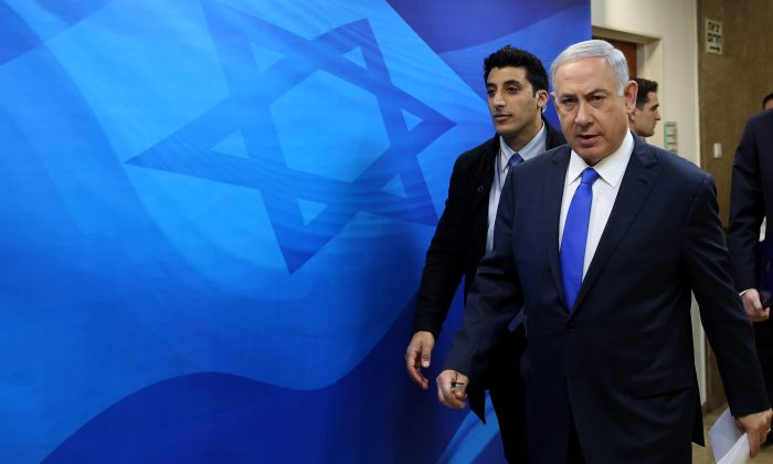 Israeli Prime Minister Benjamin Netanyahu arrives to the weekly cabinet meeting at his Jerusalem office on  Feb. 7, 2016. (Gali Tibbon/Pool via AP)