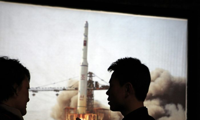 "A 2009 satellite rocket launch is displayed at the Three Revolutions Exhibition Hall in Pyongyang, North Korea, on April 10, 2012. The Unha 3 rocket that launched the ""Bright Star"" satellite into space in 2012 is a symbol of North Korea's technological successes and a matter of great national pride. The country plans another launch to put Earth observation satellite into orbit in February 2016. Although the equipment it will use is not yet known, the launch could also advance its military-use missile technology further. (AP Photo/Ng Han Guan)"