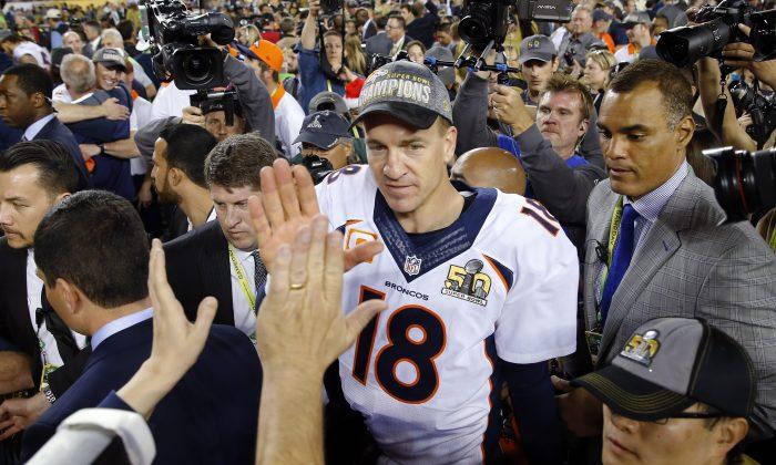 Denver Broncos' Peyton Manning (18) leaves the field after winning the NFL Super Bowl 50 football game against the Carolina Panthers Sunday, Feb. 7, 2016, in Santa Clara, Calif. The Broncos won 24-10. (AP Photo/Matt York)