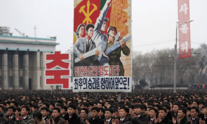 North Koreans gather at the Kim Il-Sung Square to celebrate a satellite launch in Pyongyang, North Korea, on Feb. 8, 2016. People in Pyongyang danced and watched fireworks the day after a rocket launch that has been strongly condemned by many countries around the world. (AP Photo/Jon Chol Jin)