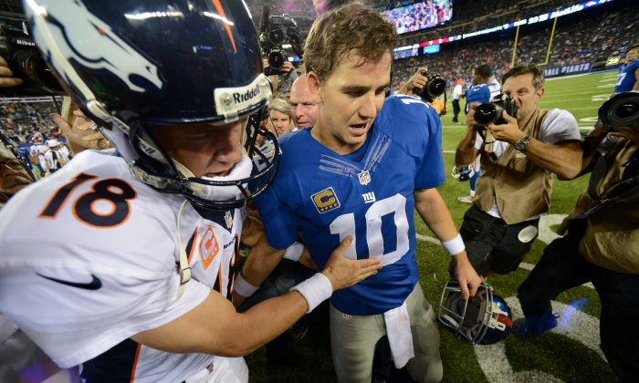 Peyton Manning (L) and Eli Manning both have won a pair of Super Bowls. (Ron Antonelli/Getty Images)