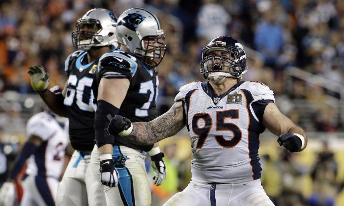 Denver Broncos' Derek Wolfe (95) celebrates after sacking Carolina Panthers' Cam Newton (1) during the second half of the NFL Super Bowl 50 football game in Santa Clara, Calif., on Feb. 7, 2016. (AP Photo/Jeff Chiu)