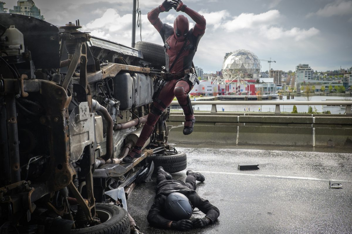superhero jumps on opponent with sword in Deadpool
