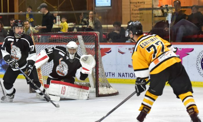 With 4 goals on the night, Lucas Eshleman of Hong Kong Tycoons lines up for a strike at the South China Shark's goal during their CIHL match at Mega Ice on Thursday Feb 4, 2016. Caption: (Cox/Epoch Times)