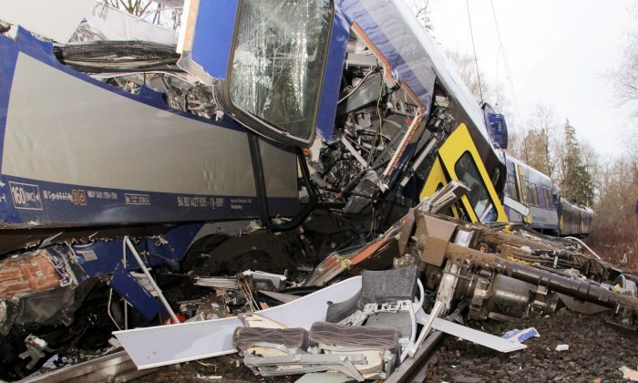 The axis sits separated from the carriage at the site of a train accident near Bad Aibling,Germany, Tuesday, Feb. 9,  2016.  (Josef Reissner/dpa via AP)