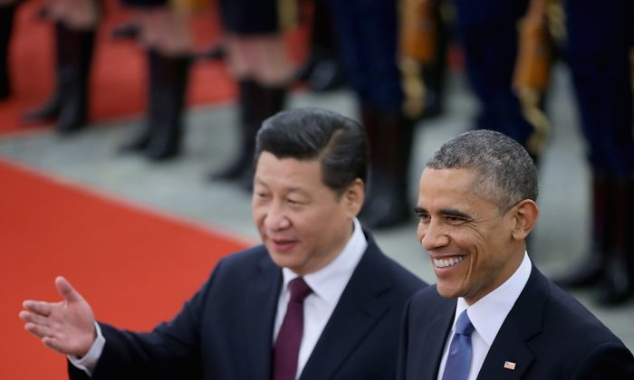 Chinese Communist Party leader Xi Jinping (L) accompanies President Barack Obama (R) to view an honor guard during a welcoming ceremony outside the Great Hall of the People on Nov. 12, 2014 in Beijing. Chinese media are having a field day criticizing the U.S. election primaries.  (Feng Li/Getty Images)