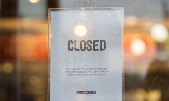 A sign showing that the Chipotle Mexican Grill seen at 1924 Beacon St. is closed on December 8, 2015 in Boston, Massachusetts. According to Boston College spokesman, 80 students have gotten sick after eating at the fast food chain.  (Scott Eisen/Getty Images)
