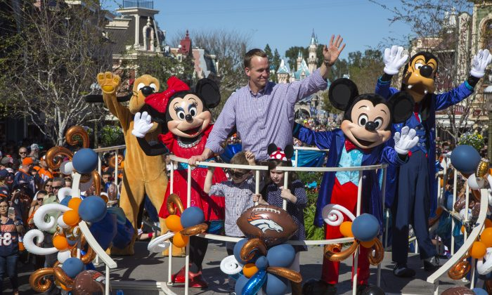 Peyton Manning joined the Disney characters in a float with his children, Mosely and Marshall. (Paul Hiffmeyer/Disneyland Resort via Getty Images)