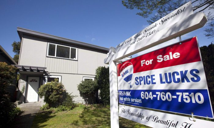 "A two-storey home for sale in the Kitsilano area of Vancouver on April 4, 2010. Some Metro Vancouver real estate agents have allegedly been involved in ""shadow flipping,"" or selling a property multiple times before the closing date. (The Canadian Press/Jonathan Hayward)"