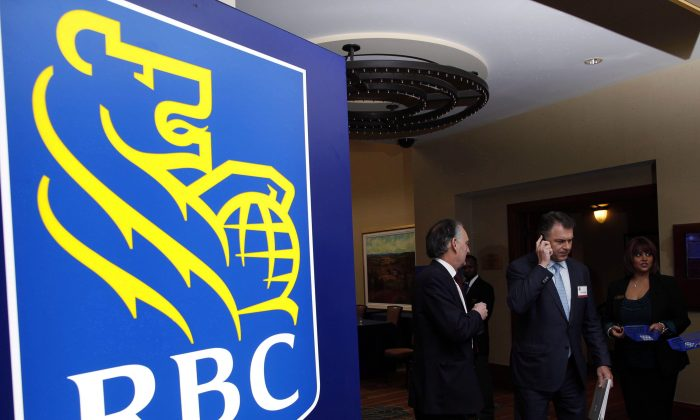 Shareholders leave the Royal Bank of Canada annual meeting in Calgary on Feb. 28, 2013. A businessman from Nova Scotia has been sentenced to four years in jail after taking $8.5 million from RBC. (THE CANADIAN PRESS/Jeff McIntosh)