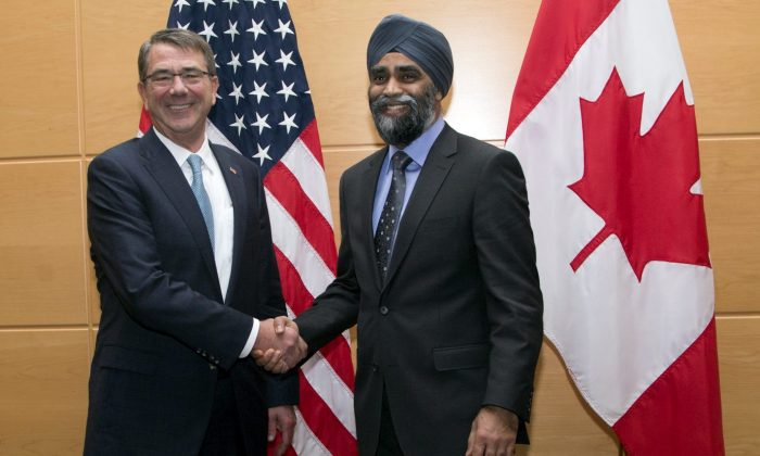 U.S. Secretary of Defense Ash Carter (L) shakes hands with Canadian Defense Minister Harjit Singh Sajjan prior to a bilateral meeting at NATO headquarters in Brussels on Feb. 10, 2016.  (AP Photo/Virginia Mayo, Pool)