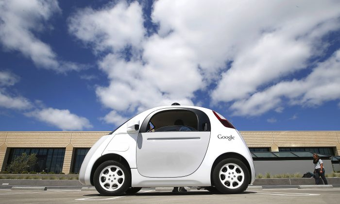 In this May 13, 2015, file photo, Google's new self-driving prototype car is presented during a demonstration at the Google campus in Mountain View, Calif. (AP Photo/Tony Avelar)