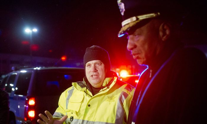 Muskegon County Sheriff Dean Roesler talks to the media as police investigate shootings in the parking lot of Muskegon Heights High School in Muskegon Heights, Mich., Tuesday, Feb. 9, 2016. The shootings happened around 9:30 p.m. after a basketball game at the high school. (Joel Bissell/MLive-Muskegon Chronicle via AP) ALL LOCAL TELEVISION OUT; LOCAL TELEVISION INTERNET OUT; MANDATORY CREDIT