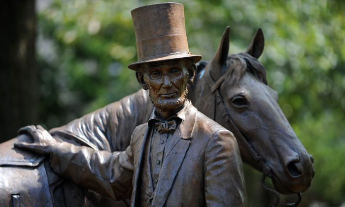 A life size statue of President Abraham Lincoln in front of the entrance to his summer retreat where he lived during a quarter of his presidency and commuted to the White House on horse back, on the property of the Armed Forces Retirement Home in Washington, D.C., on Aug. 12, 2010. (Tim Sloan/AFP/Getty Images)