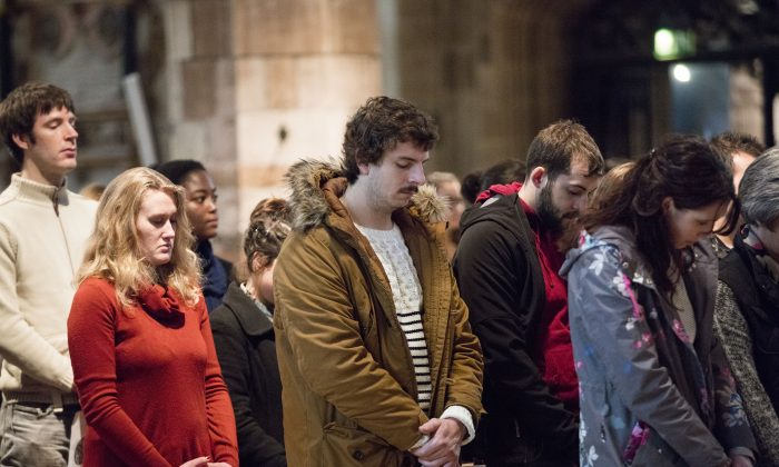 Members of the congregation bow their heads in prayer during a special service in solidarity with the people of Paris after Friday's terrorist attacks at St Giles Cathedral on November 15 2015 in Edinburgh, Scotland.(James Glossop - WPA Pool/Getty Images)