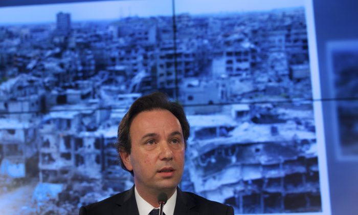 Syrian National Coalition President Khaled Khoja at a news conference in Moscow, Russia, on Aug. 14, 2015. (AP Photo/Ivan Sekretarev)