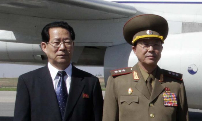 Kim Hyong Jun (L), deputy minister of Foreign Affairs, and Ri Yong Gil, col. gen. of the Korean People's Army, before leaving Pyongyang Airport in North Korea for China on May 22, 2013. (AP Photo/Kim Kwang Hyon)