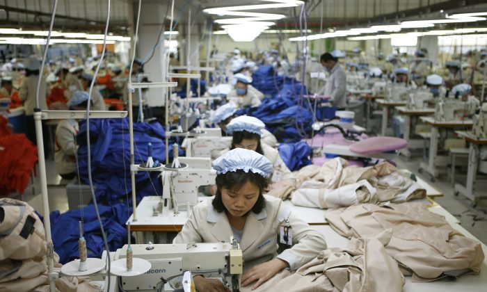 North Korean workers assemble jackets at a factory of a South Korean-owned company at the jointly-run Kaesong Industrial Complex, in Kaesong, North Korea, on Dec. 19, 2013. (Kim Hong-ji/AP)