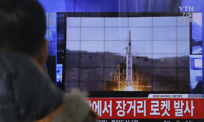 A South Korean man watches a TV news program with a file footage about North Korea's rocket launch at Seoul Railway Station in Seoul, South Korea, on Feb. 7, 2016. (Ahn Young-joon/AP)